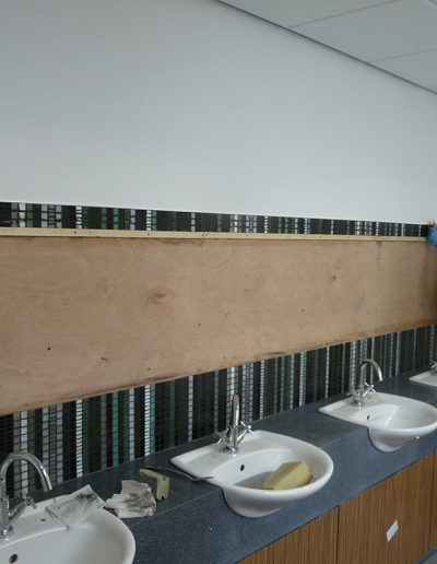 Dunbar Primary School, installing the mosaic in the staff toilets