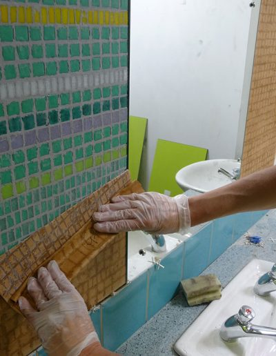 Dunbar Primary School, removing the paper from the mosaic face