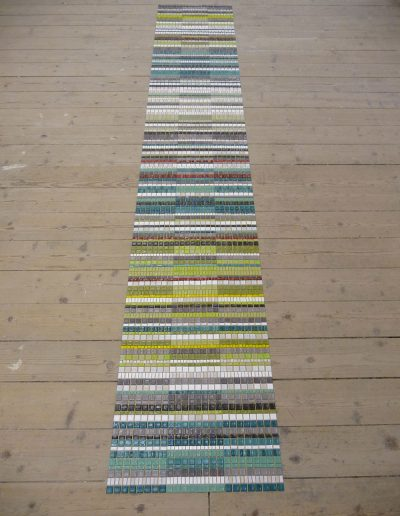 Weave, studio, mosaic laid out on floor
